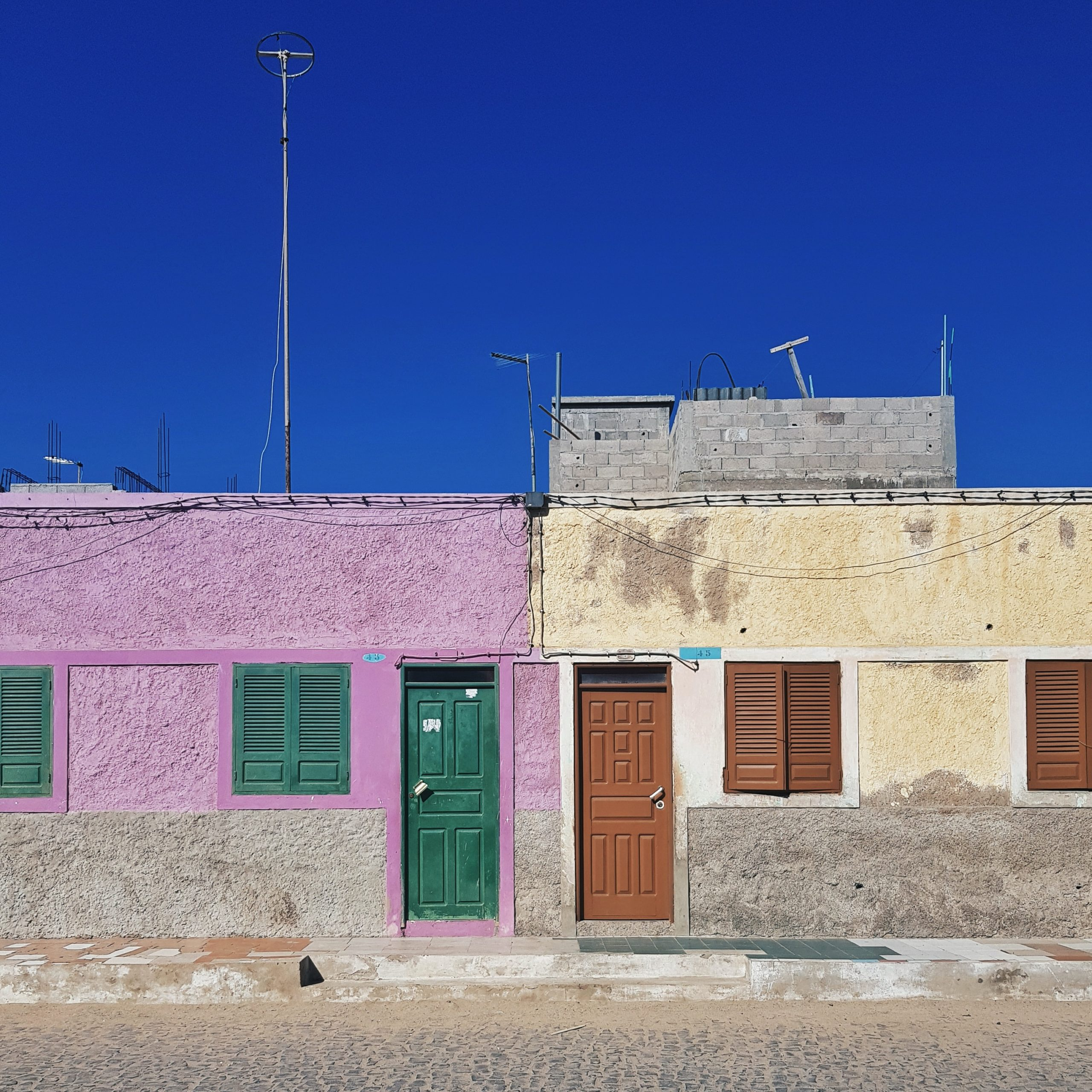 purple and yellow concrete houses during day time